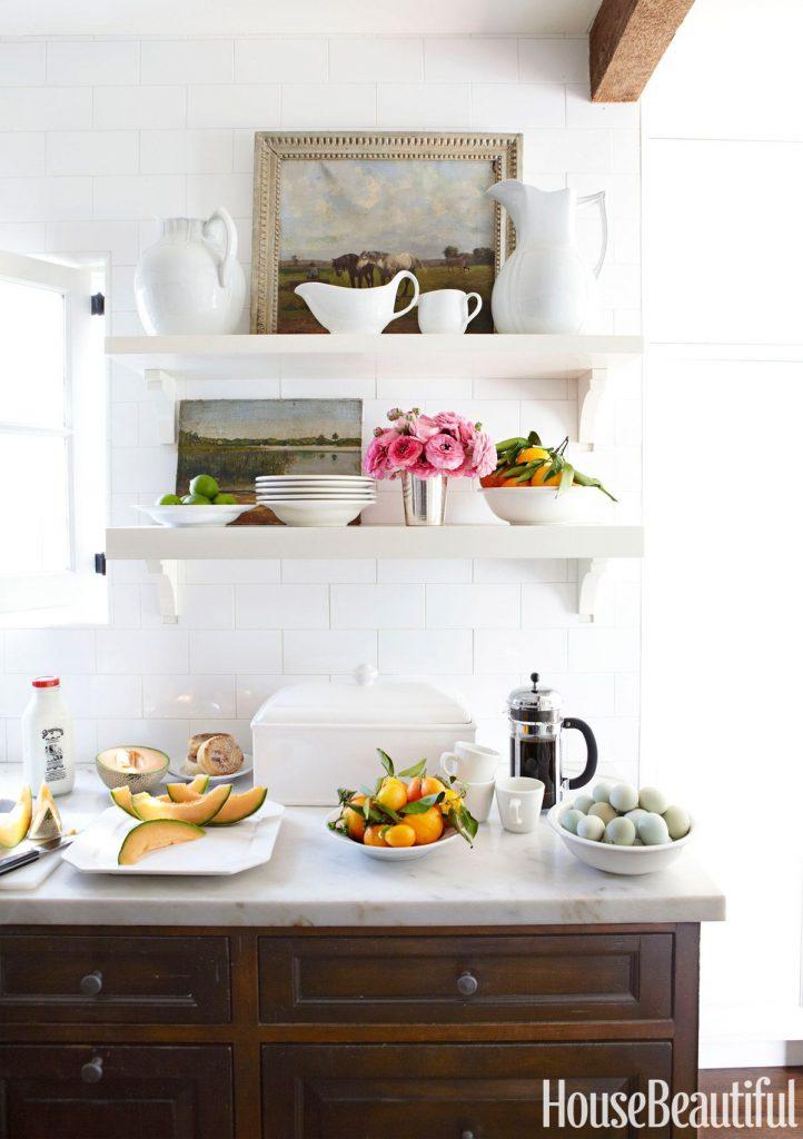 art in the kitchen wood cabinets white open shelves artwork white ironstone charming vignette