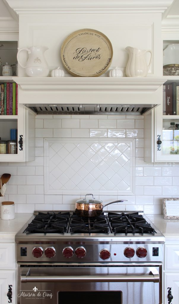 kitchen mantel display with ceramic pumpkins fall decorating idea