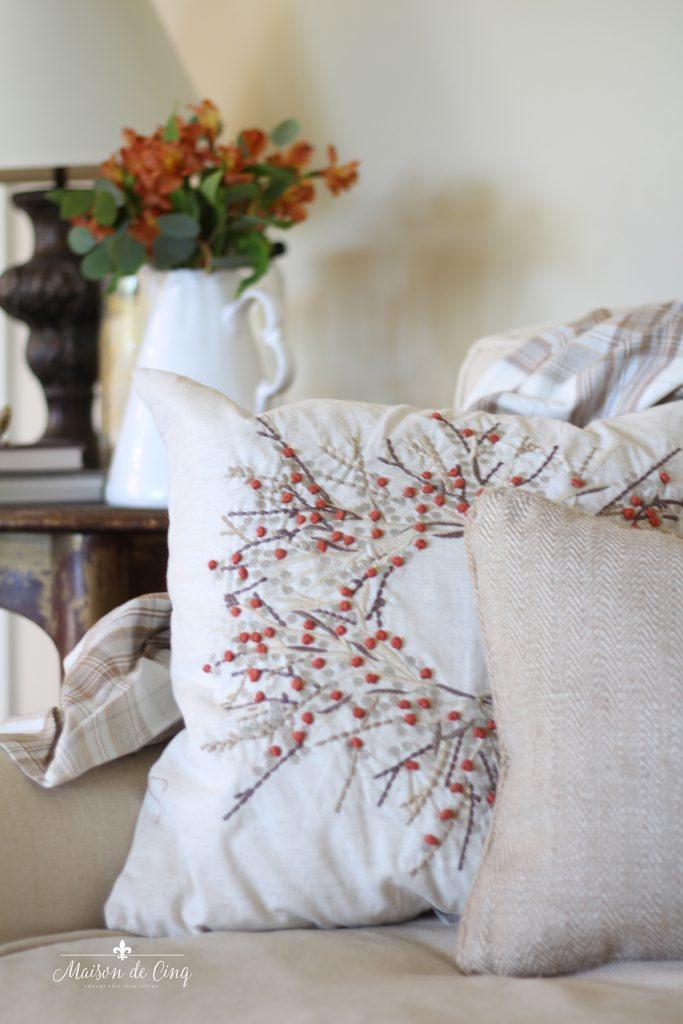fall pillows on sofa with cozy throw