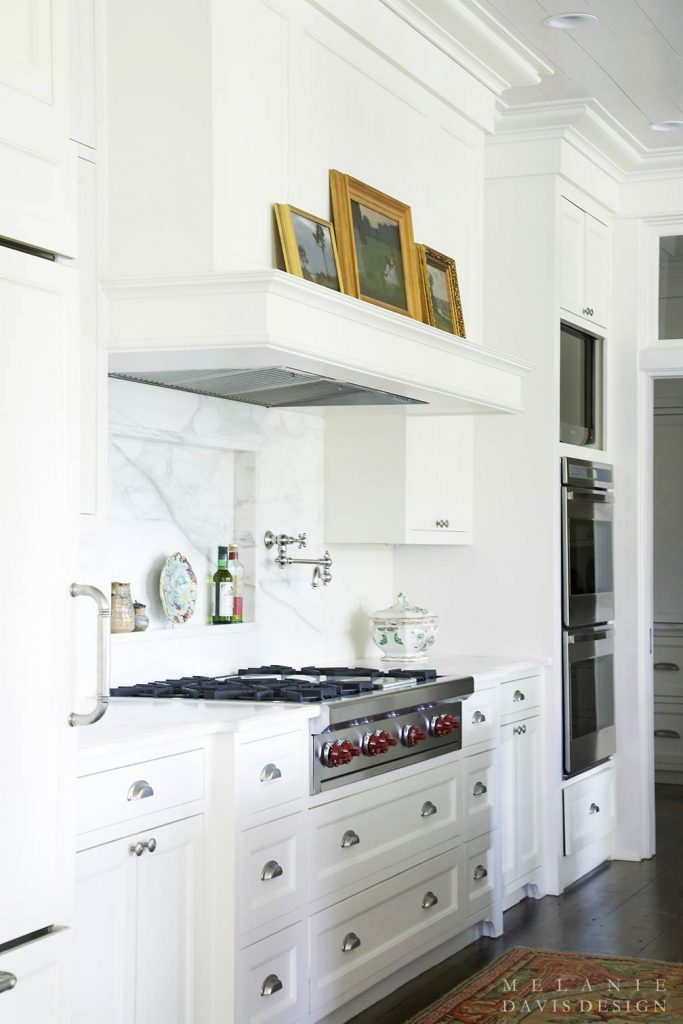 art in the kitchen on stove mantel white kitchen marble counters gorgeous