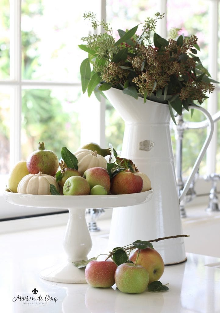 white pumpkins with apples and eucalyptus fall decor display kitchen counter