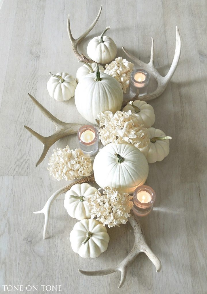 white pumpkins with antlers and hydrangeas centerpiece stunning fall tablescape