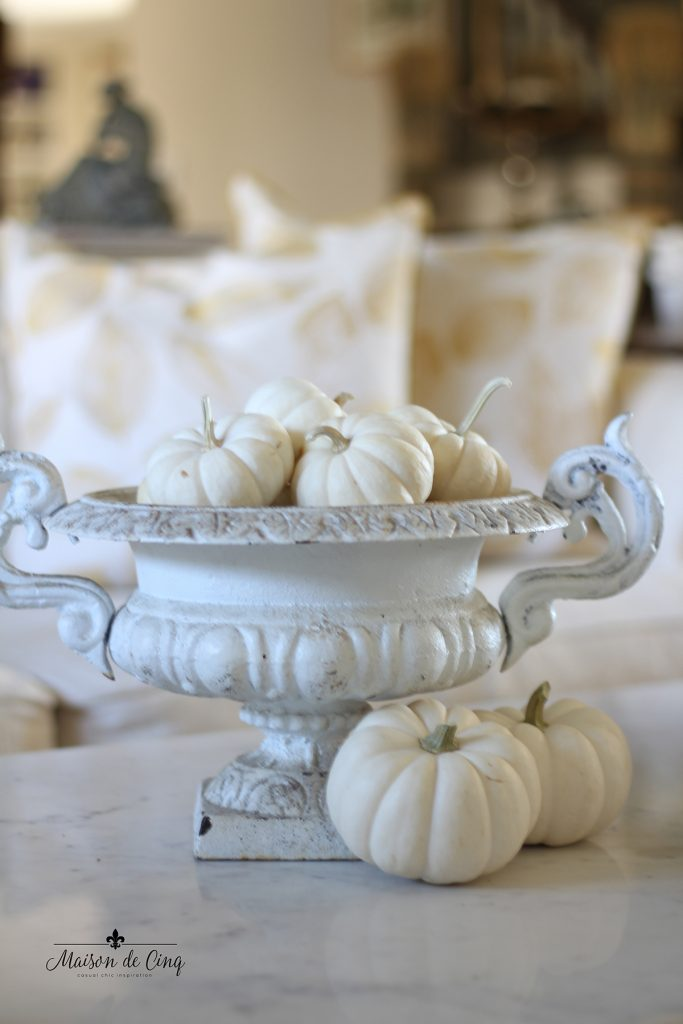antique French urn filled with baby boo white pumpkins gorgeous French country fall decor
