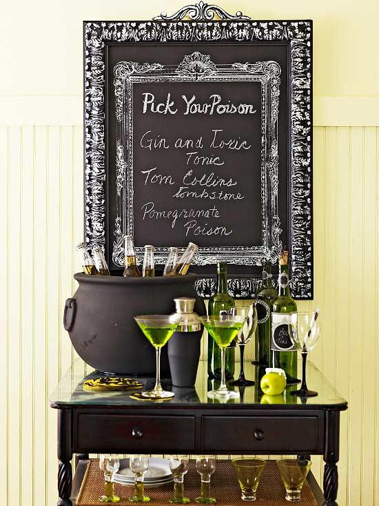 black and white halloween decor bar setup drinks cauldron chalkboard sign