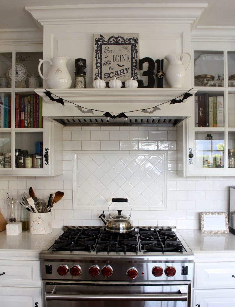 black and white halloween decor in white kitchen range hood mantel decor
