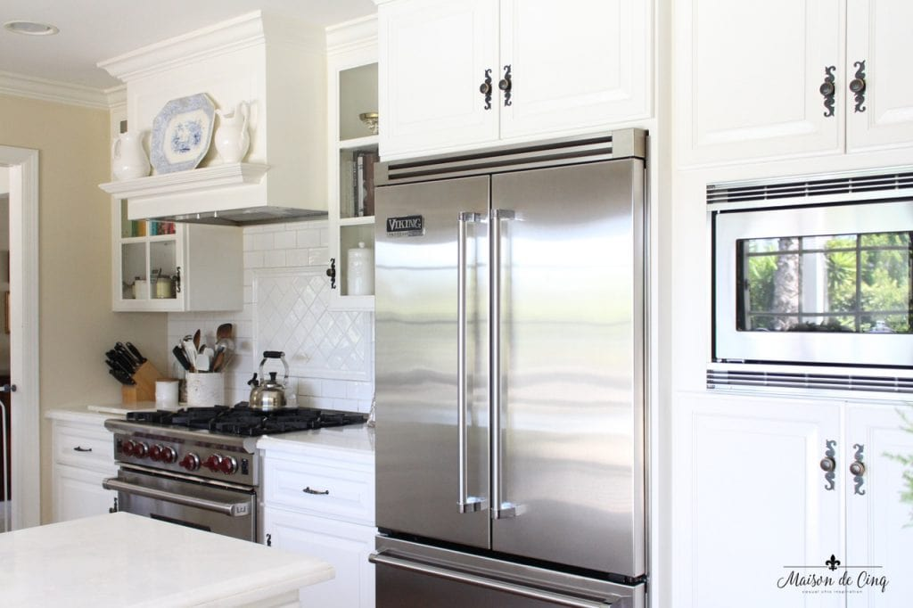 kitchen renovation farmhouse style range view refrigerator white cabinets