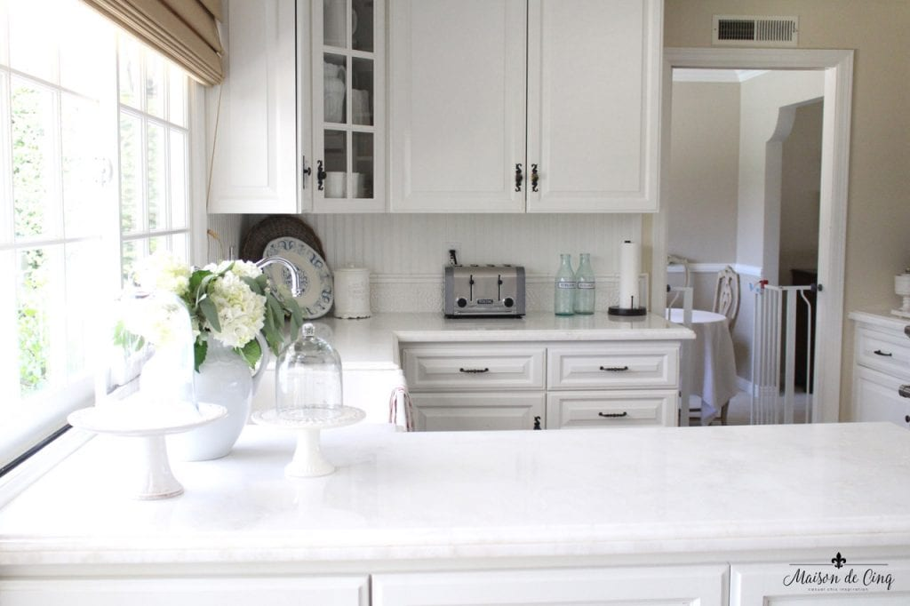 kitchen renovation farmhouse style white kitchen marble counters cake stands hydrangeas