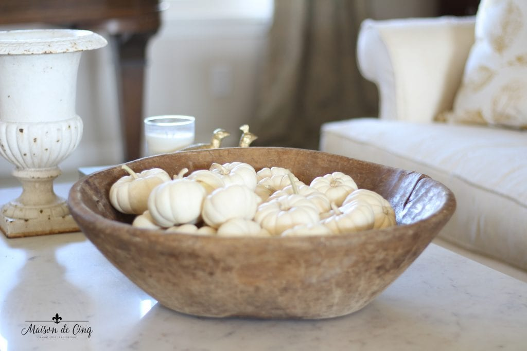 neutral fall decor antique dough bowl with white pumpkins