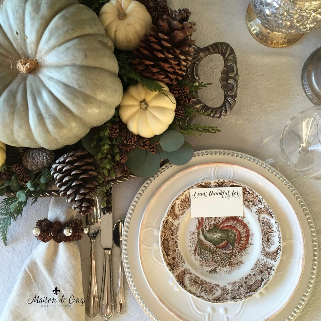 thanksgiving tablescape turkey plates and pinecones pumpkins on silver tray
