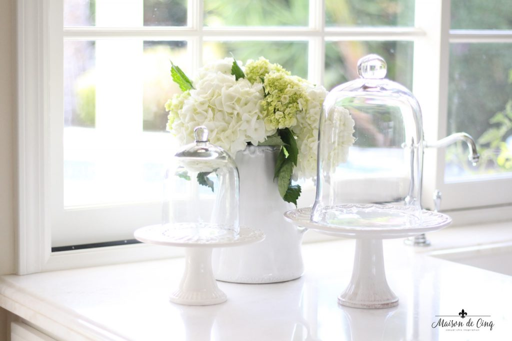kitchen renovation cake stands and hydrangeas on marble counter windows farmhouse style