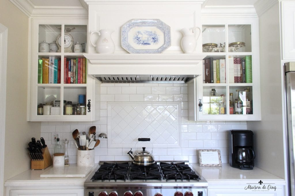 kitchen renovation white farmhouse style range hood mantel over stove blue transferware white ironstone