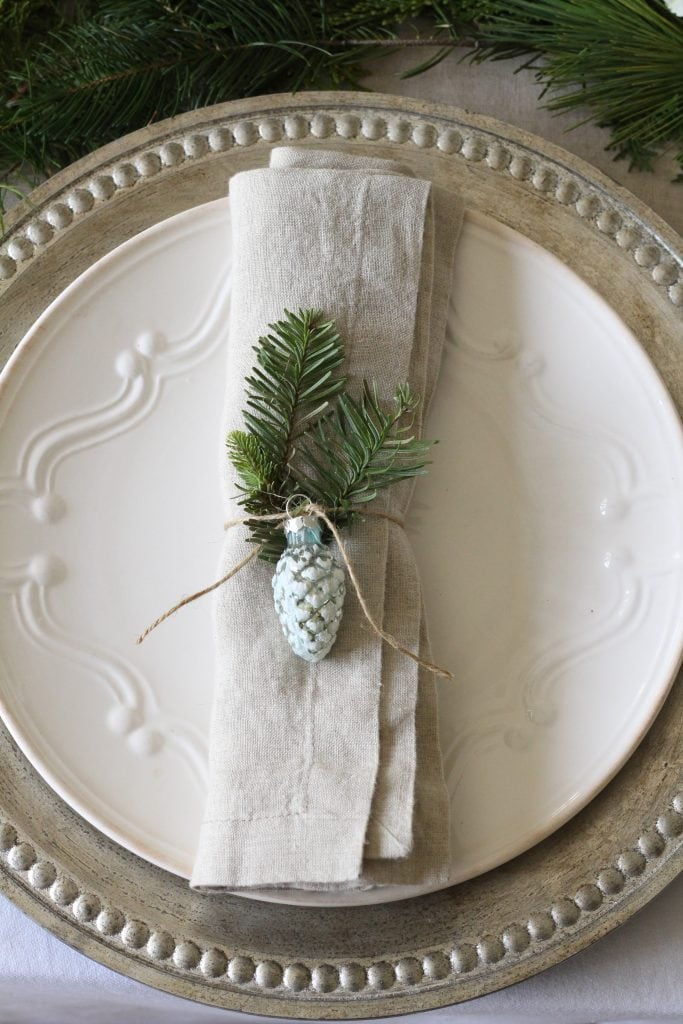 gorgeous holiday tablescape with neutrals silvers and greens