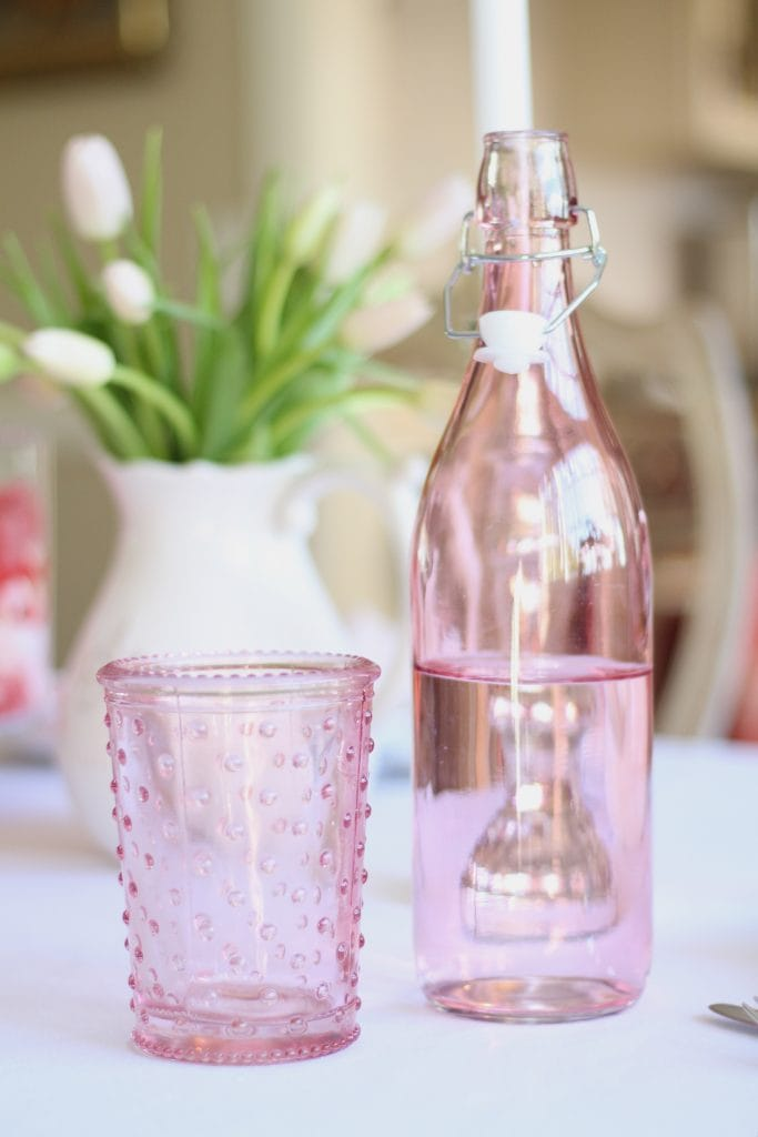 valentines-day-table-with-tulips-and-pink-glasses water bottle