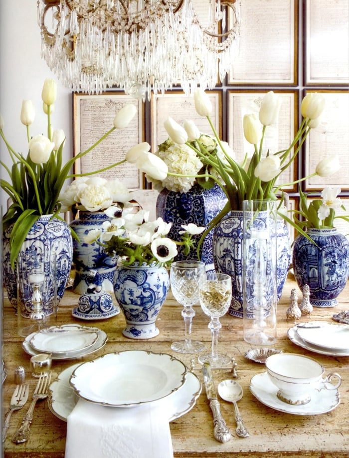 stunning tablescape with white tulips in blue and white ginger jars French farmhouse charm