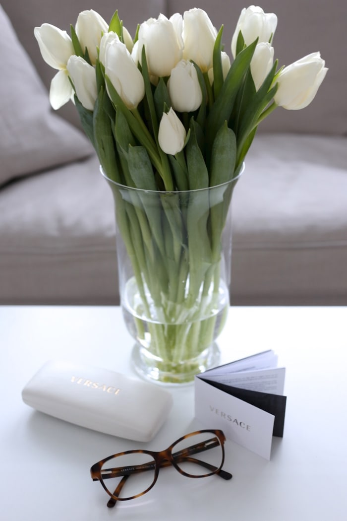 simple white tulips in glass vase decorating with flowers