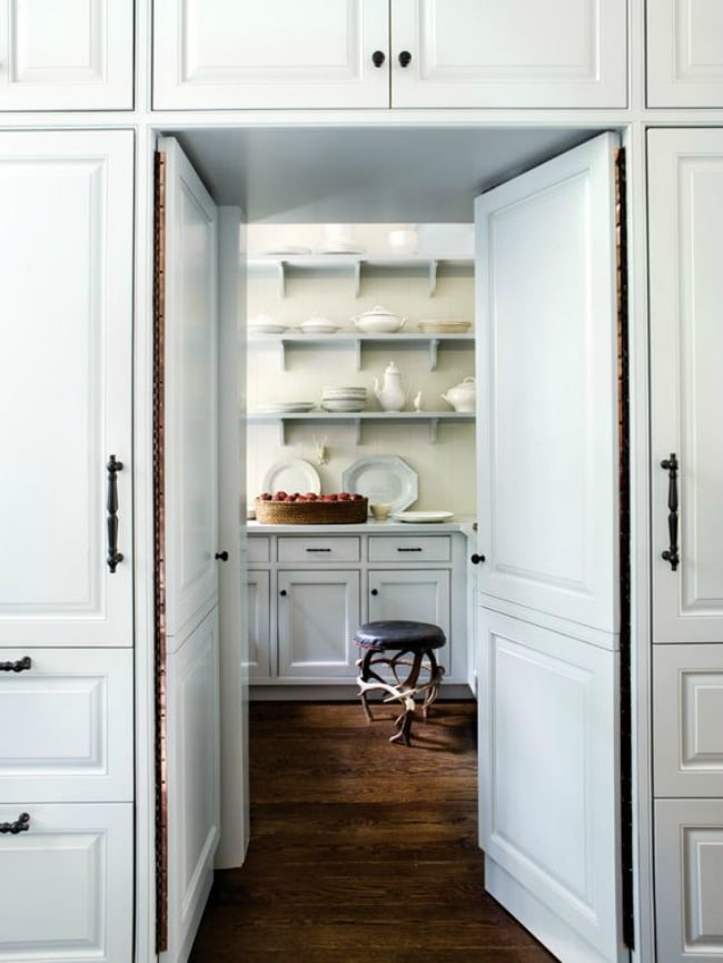 white-kitchen-butlers-pantry white plates and dishes wood floors