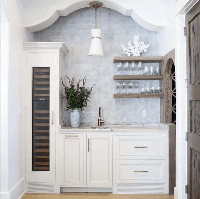 gorgeous archway and marble walls create butler's pantry space
