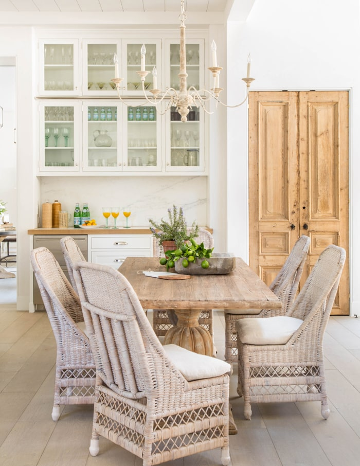 French farmhouse kitchen with wicker chairs and small butler's pantry