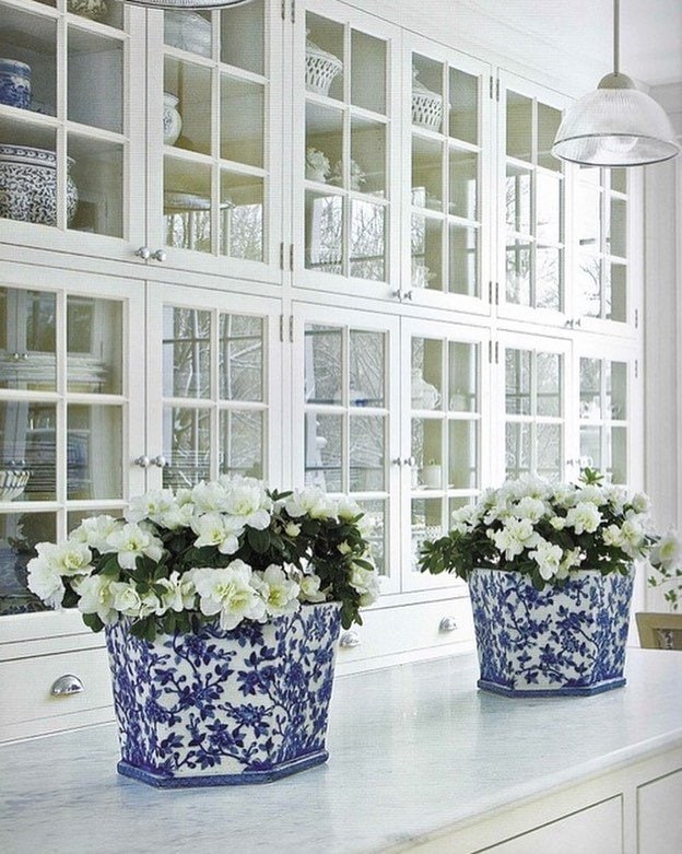gorgeous white built ins holding dishes and china white kitchen