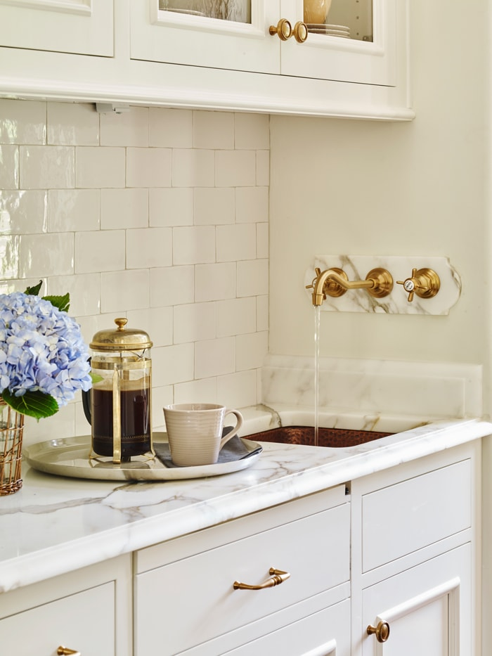 brass-faucet-white-subway tile marble counter kitchen details