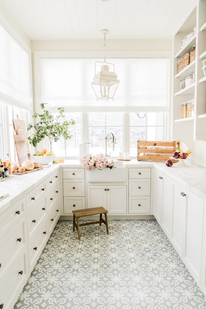 stunning white butler's pantry with cement patterned tile gorgeous lantern