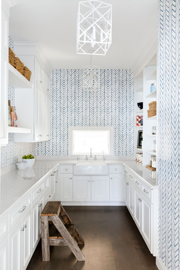 butler's pantry with blue and white wallpaper