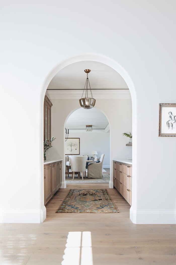 modern transitional design archway to dining room