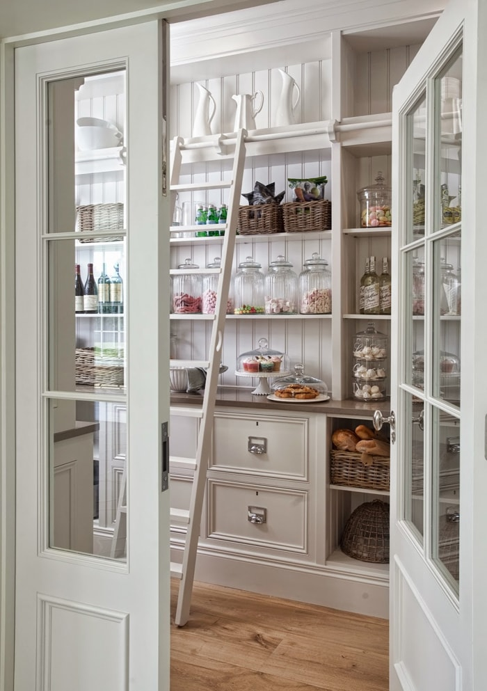 gorgeous butler's pantry with beadboard and ladder