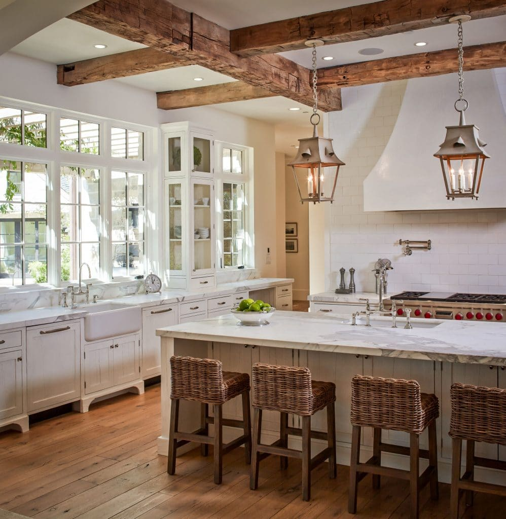 french farmhouse kitchens wicker barstools wood ceiling beams lanterns farmhouse sink gorgeous