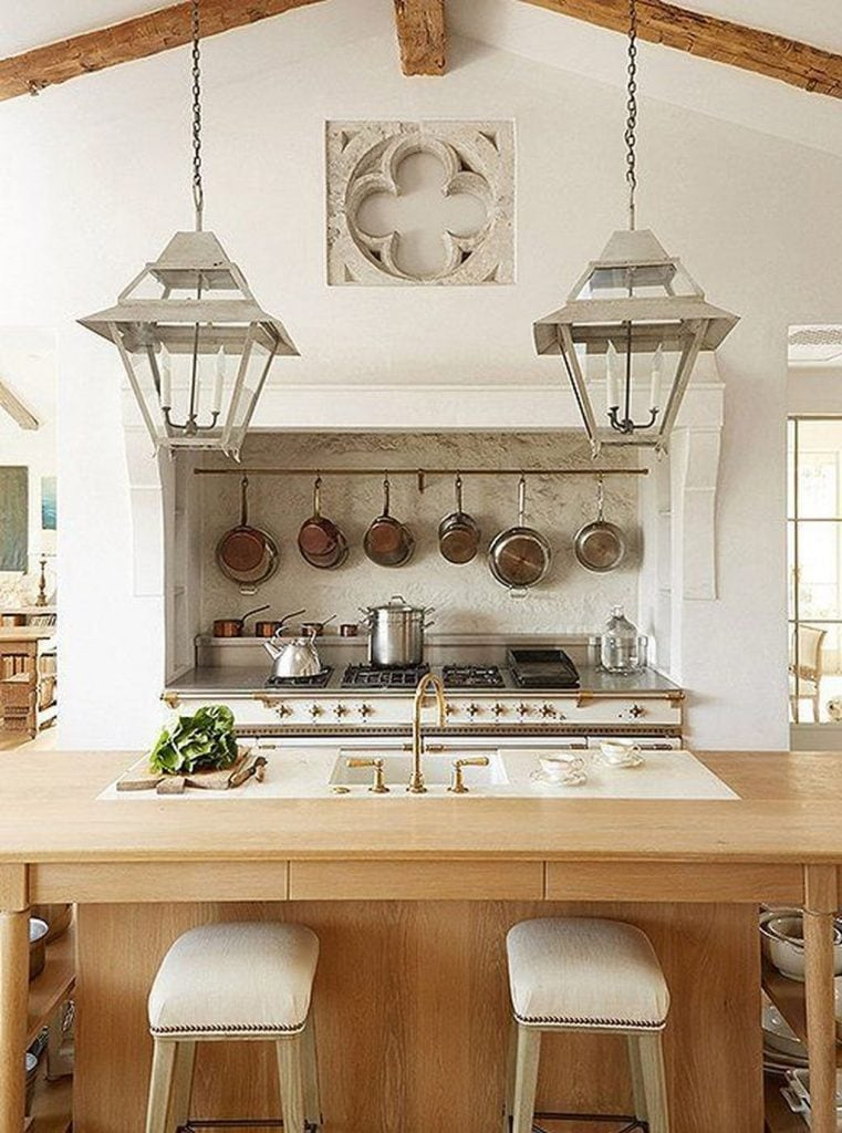 french farmhouse kitchens wood beams gorgeous antique lanterns copper pots range with mantel wood counters
