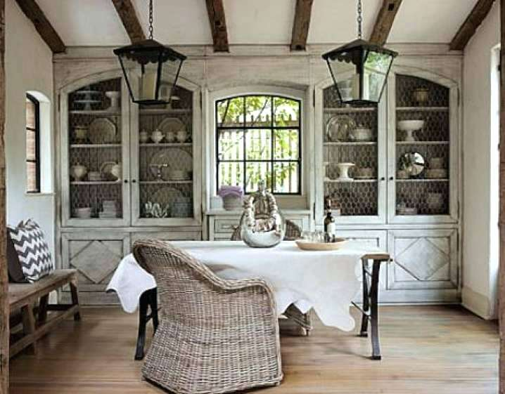 french farmhouse kitchens twin antique lanterns wicker chair chicken wire on cabinets
