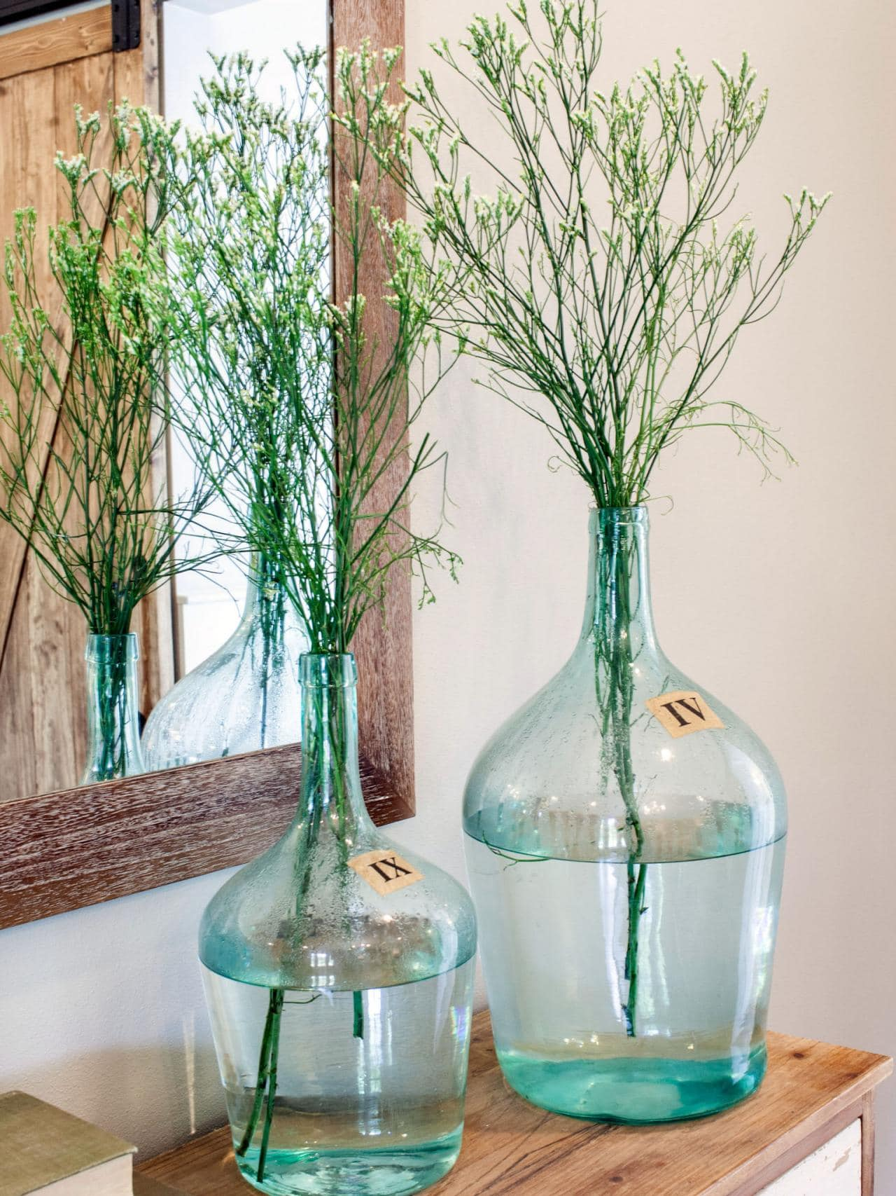 antique-demijohns-reproductions green bottles branches display