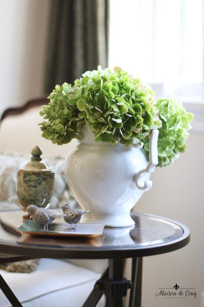 decorating with flowers green hydrangeas white pitcher on glass table french country style