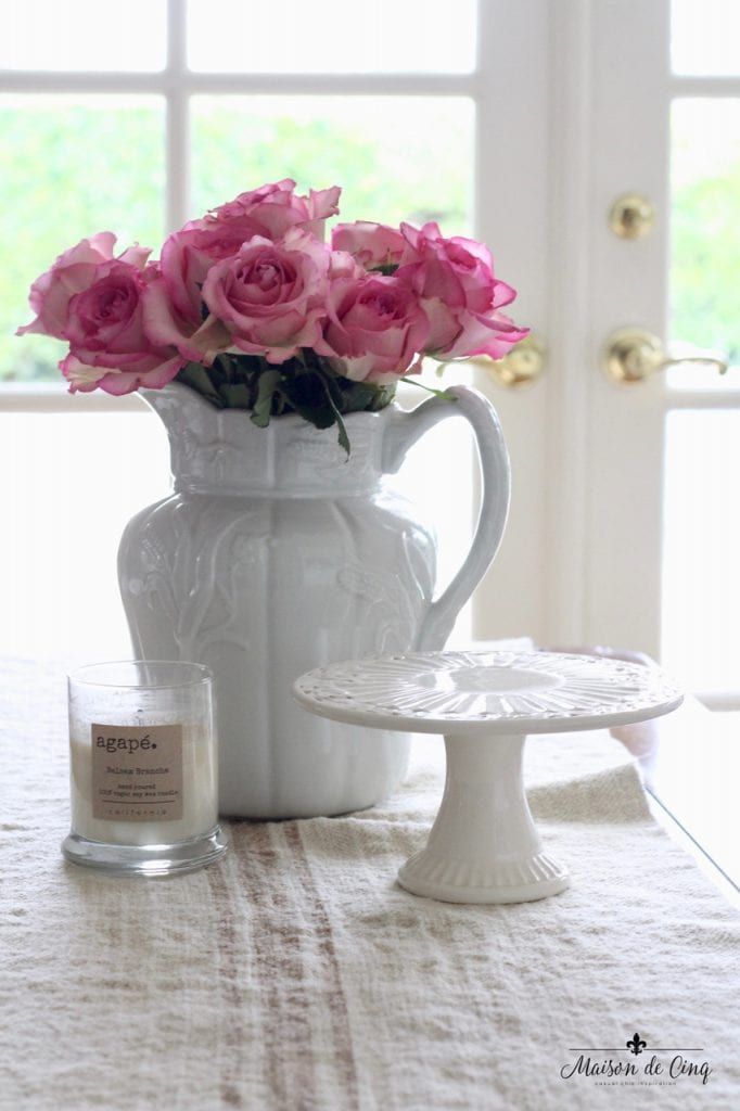 decorating with flowers gorgeous pink roses in white vintage ironstone pitcher cake stand candle charming french country vignette