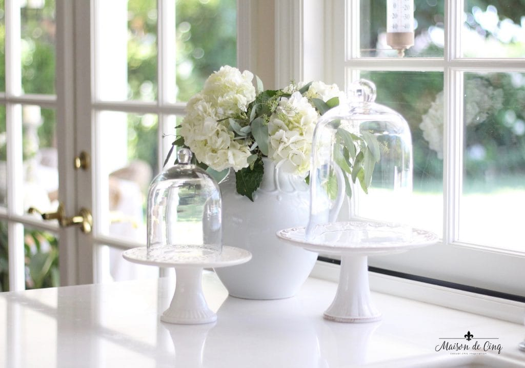 decorating with flowers hydrangeas in white ironstone pitcher with cake stands charming vignette white kitchen