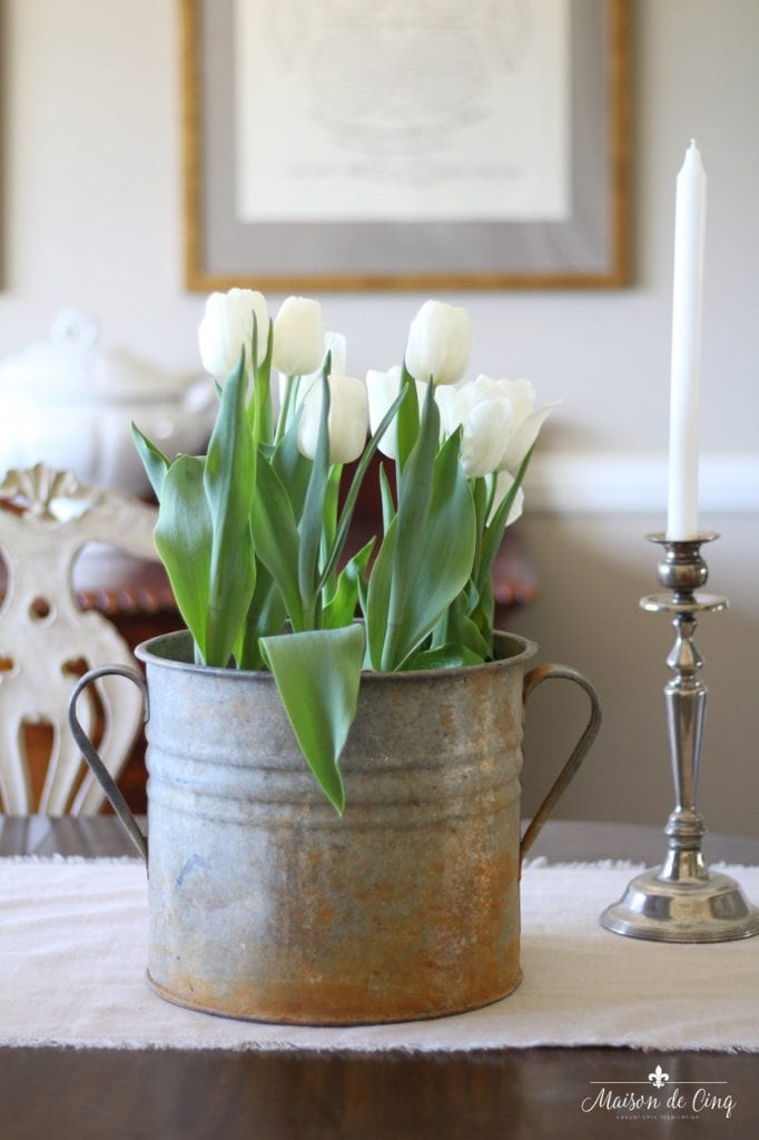 decorating with flowers white tulips in vintage zinc bucket french country style dining room