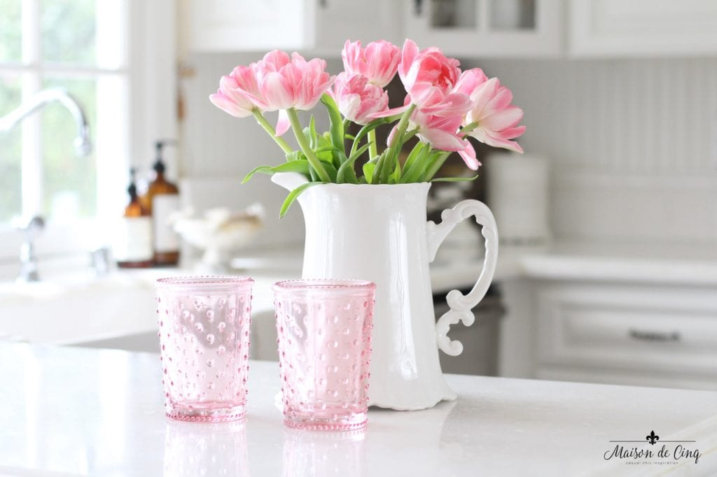 decorating with flowers pink tulips in white pitcher white farmhouse kitchen decor