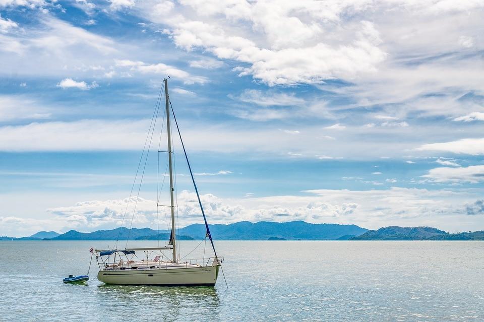 rising-tide-boat-ocean