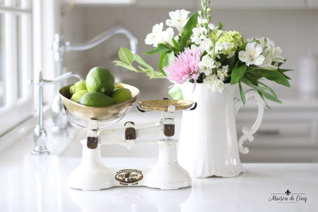 decorating with flowers white pitcher vintage scale holding limes in gorgeous white kitchen
