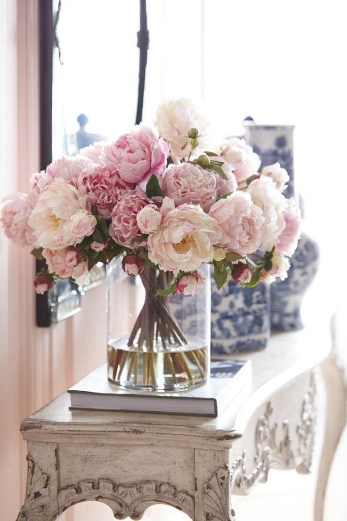 gorgeous-pink-peonies-console-table with blue and white ginger jars vignette