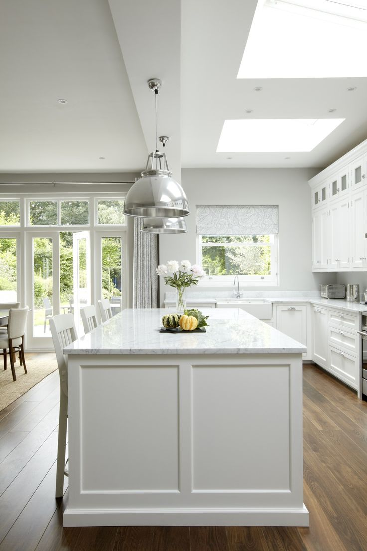 Friday favorites grey white kitchens for Are white kitchen cabinets still in style