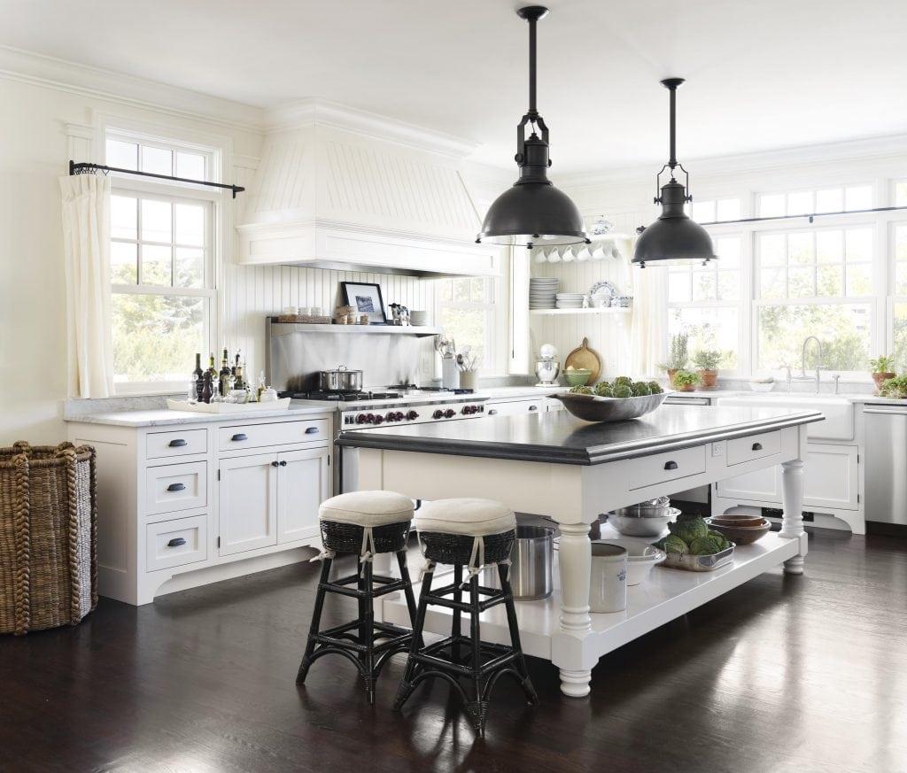 black and white kitchen farmhouse style black lanterns and island