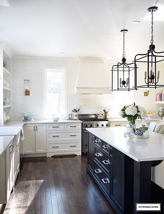 black and white kitchen black island marble countertops