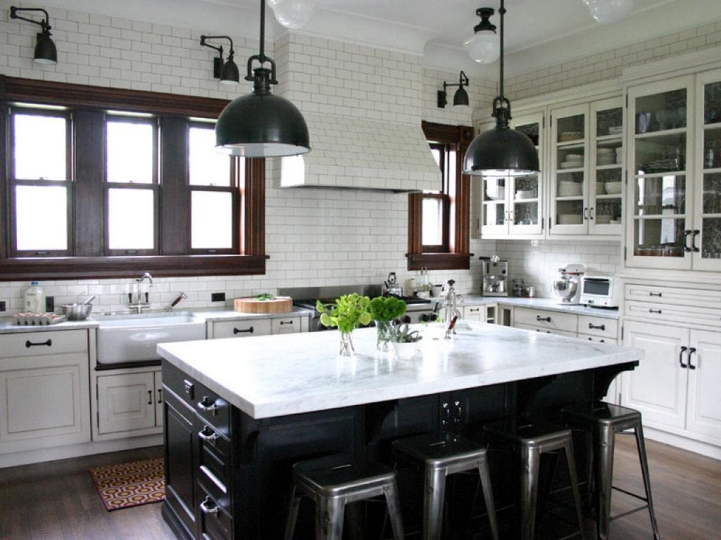 black and white farmhouse kitchen black island vintage lanterns white subway tile