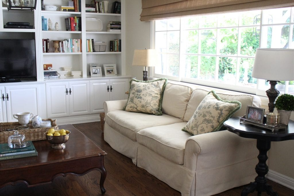 family room farmhouse style cream sofa built ins