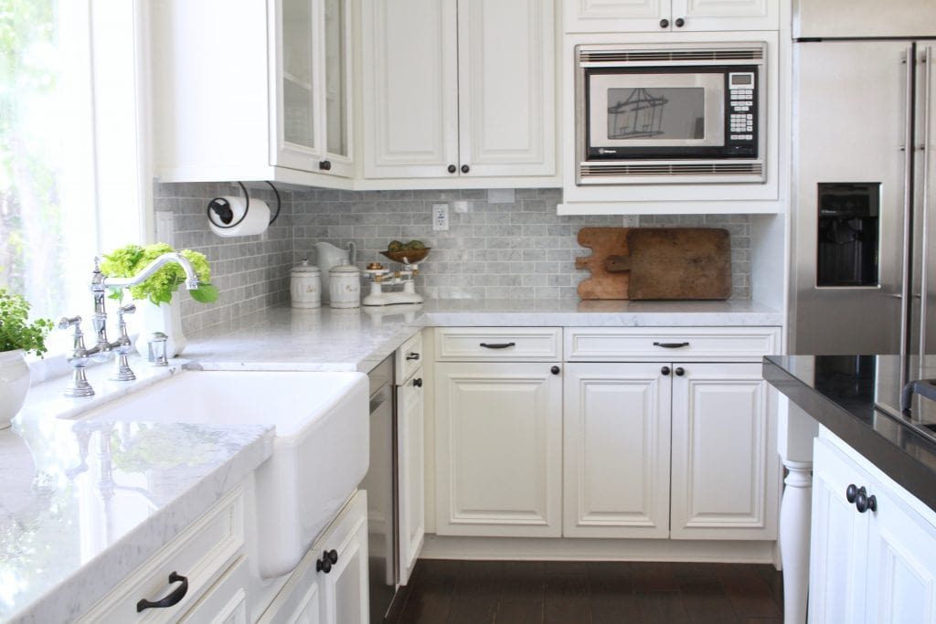 farmhouse inspired white kitchen marble counters subway tile