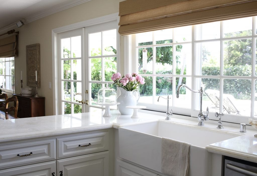white kitchen charming farmhouse sink big windows