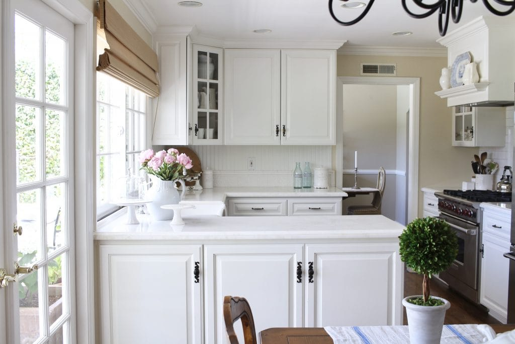 white kitchen with marble and subway tile
