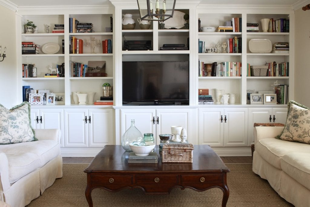 white book shelves family room built ins styling