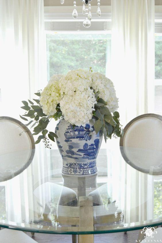 white hydrangeas blue and white vase stunning neutral dining room